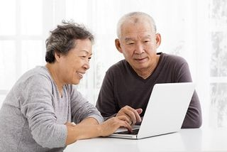 Elderly couple review finances