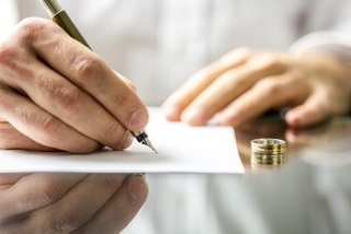 Man signing divorce papers