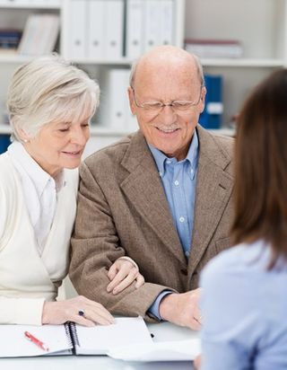 Elderly couple receiving financial advice